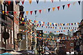 TQ7468 : Bunting on High Street by Oast House Archive