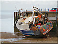 TR1067 : Boat at Whitstable Harbour, Low Tide by David Dixon