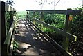 TL0040 : Footbridge on the path to Manor Farm by Philip Jeffrey