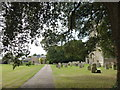 TL1885 : Conington House and All Saints graveyard by Richard Humphrey