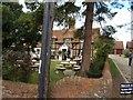 SP8019 : The Bell Inn through the trees by John Firth