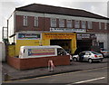 ST5878 : Garage and church, Southmead, Bristol by Jaggery