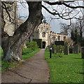 TL1967 : Buckden: church path and porch by John Sutton