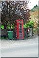 SO4071 : Red phone box and green wheelie bin by John Winder