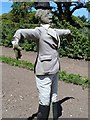 SW9946 : Scarecrow in the vegetable plot by John Firth