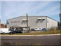TM0090 : T2 Hangar on the Chalk Farm Industrial Estate by Evelyn Simak