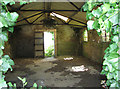 TF9039 : View into an old RAF building by Evelyn Simak