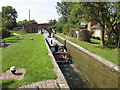SP8713 : A narrowboat leaves the empty Red House Lock, Aylesbury Arm by David Hawgood