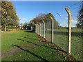 TL4066 : Fence around Rampton Drift by Hugh Venables