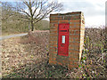 TM4884 : Victorian postbox in a brick pillar next to Moat Farm by Adrian S Pye