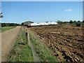 TF7833 : Farm track by Bircham Newton by Evelyn Simak