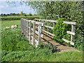 TF1306 : Wooden footbridge across South Drain near Etton by Paul Bryan
