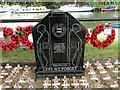 TG2608 : Commemorative plaque at the War Memorial at Thorpe by Adrian S Pye