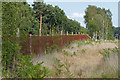 SU9666 : Railway fence, Chobham Common by Alan Hunt