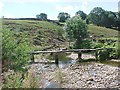 NY7110 : Clapper bridge over Helm Beck by Tim Glover