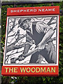 TQ4464 : The Woodman sign by Oast House Archive