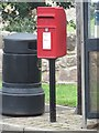 The postbox located in the centre of the village of Paxton.