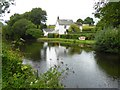 ST0113 : Waterside House and small quay at Rock Bridge by David Smith