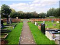 SJ4967 : Graveyard at St Andrew's Church by David Dixon