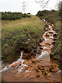 NZ1451 : Iron-stained stream at Stony Heap by Trevor Littlewood