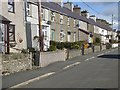 SH4468 : Village street in Llangaffo by Oliver Dixon