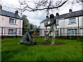 H4572 : Digging for potatoes sculpture, Campsie, Omagh by Kenneth  Allen