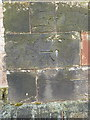 SJ8220 : OS benchmark and bolt - Gnosall, St Lawrence's Church by Richard Law