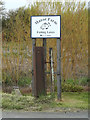 TM1853 : Manor Farm Fishing Lakes sign by Adrian Cable