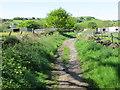 SE0936 : Cross Lane descending into Wilsden by Peter Wood