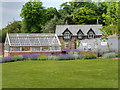 SJ8383 : Greenhouse and Gardener's Cottage at Quarry Bank Upper Garden by David Dixon