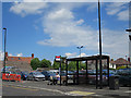 TL2797 : Car Park and Bus Stop by Anne Burgess