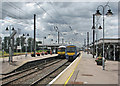 TL5479 : Two trains at Ely by John Sutton