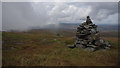 NY6834 : Cairns on Cross Fell by Ian Taylor