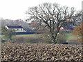 TG0723 : Wood Farmhouse, Kerdiston by Adrian Cable