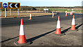 TG1515 : Traffic cones on Fir Covert roundabout by Evelyn Simak