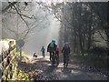 SJ5470 : Cycling family, with dog by Stephen Craven
