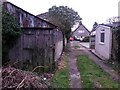 SZ1392 : West Southbourne: disused garage on footpath H14 by Chris Downer