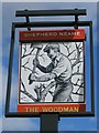 TQ5399 : The Woodman sign by Oast House Archive