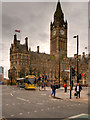 SJ8398 : Metrolink Second City Crossing, Tram Passing Manchester Town Hall by David Dixon