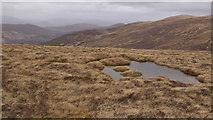 NH3051 : Lochan on the northern spur of Meall Giubhais (663 m) by Julian Paren