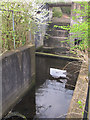 SE1628 : Sluice of a small reservoir, Low Moor by Stephen Craven