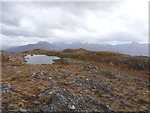 NG9473 : Lochan with a view by Richard Law