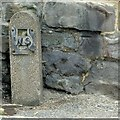 SK3547 : Bench mark, 14 High Street, Belper by Alan Murray-Rust