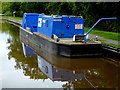 SJ6049 : Canal maintenance boat near Ravensmoor, Cheshire by Roger  Kidd