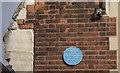 TQ3489 : The Good Shepherd, Minchley Road, Tottenham Hale, London N17 - Blue plaque by John Salmon