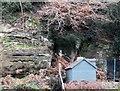TQ4621 : Garden shed among massive sandrocks, Uckfield by Patrick Roper