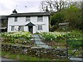 NY3404 : Cottage under Loughrigg Fell by Jo Wood