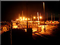SW4931 : Long Rock level crossing and the Penzance train depot by night by Jim Champion