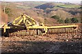 SW7845 : Agricultural Implement and Valley near Langarth by Tony Atkin