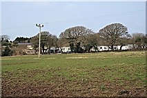 SW8559 : Holiday Village beyond the Field by Tony Atkin
